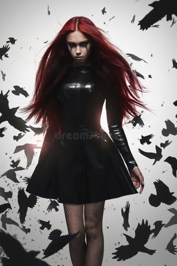 美丽的goth女主人罪恶女孩 库存图片