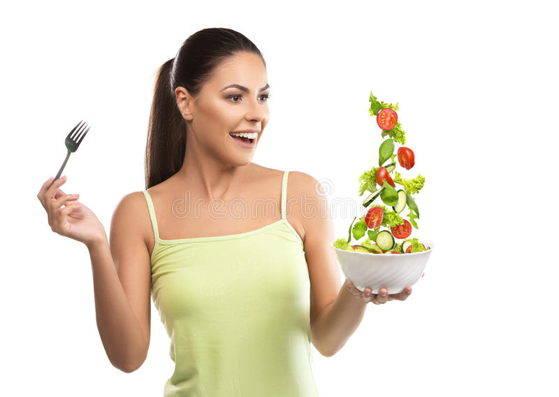 美丽,拿着沙拉的适合少妇 免版税库存图片