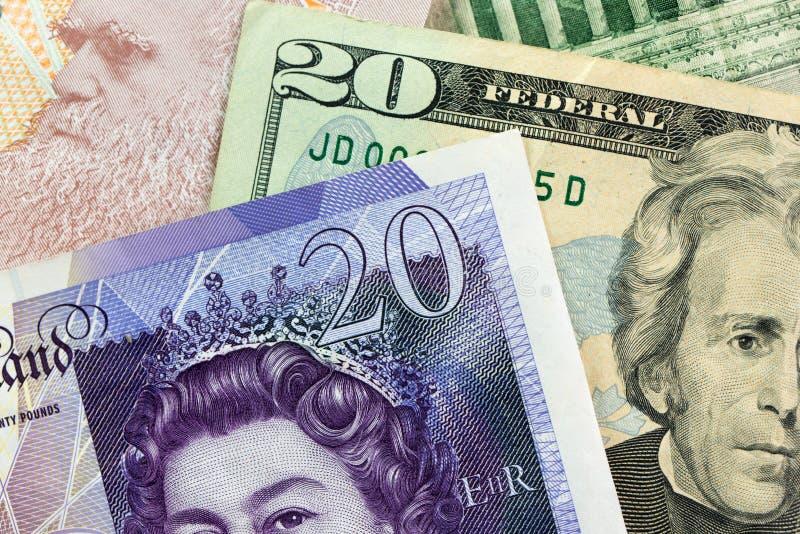 美元和磅货币笔记 免版税库存照片