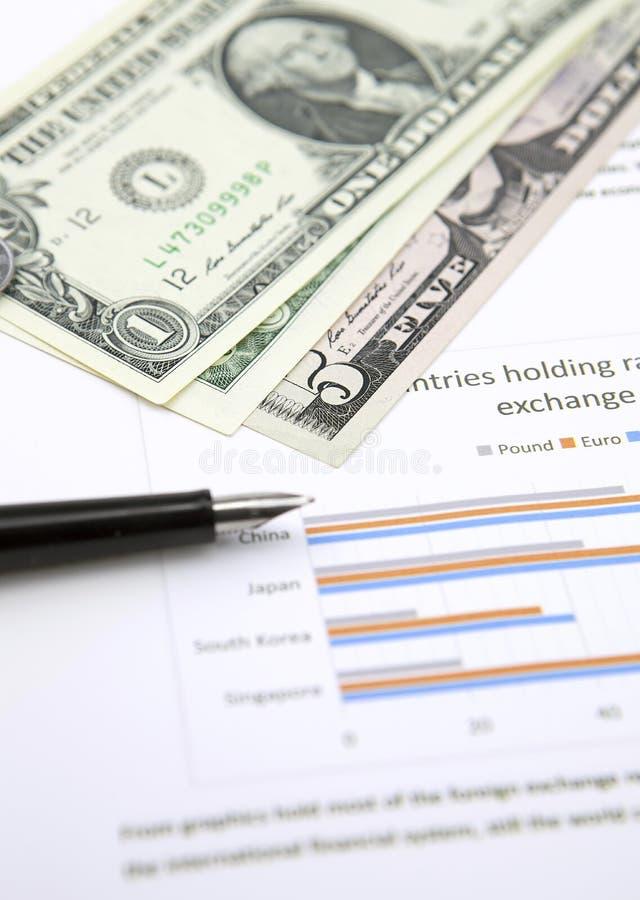 美元和笔在图 免版税库存图片