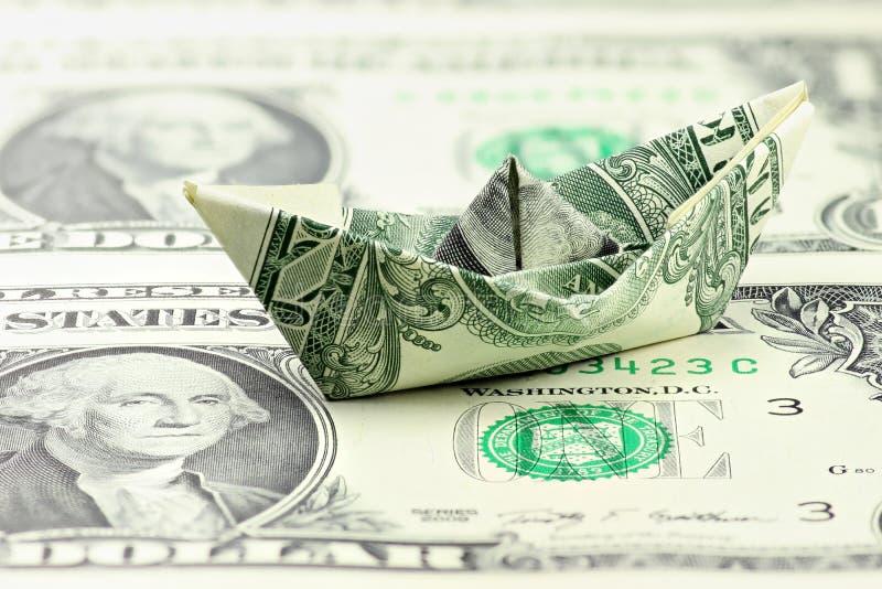 美元纸小船 免版税库存照片