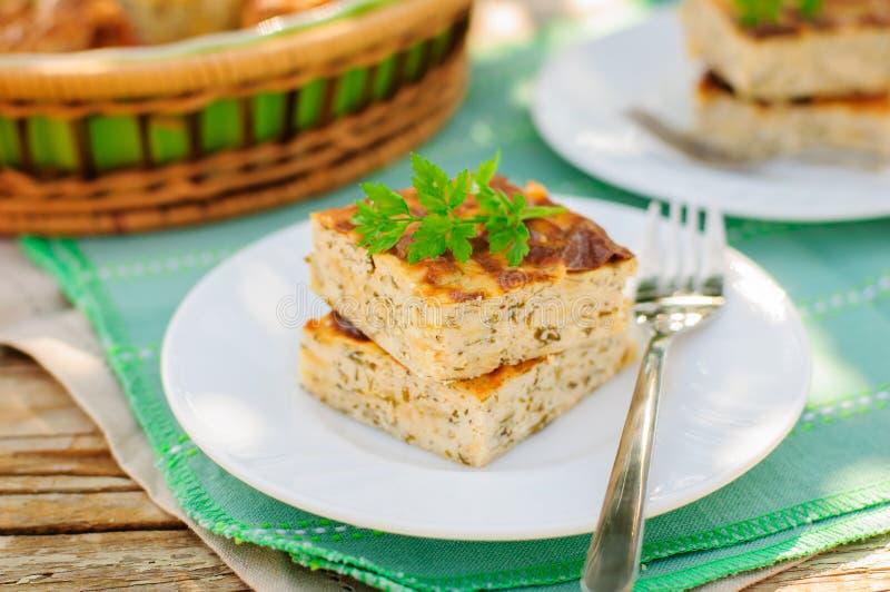 美味乳酪蛋糕(酸奶干酪烘烤) wiith草本 图库摄影