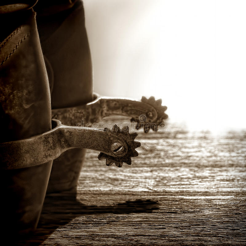 美国人启动牛仔骑马圈地踢马刺西部 库存照片