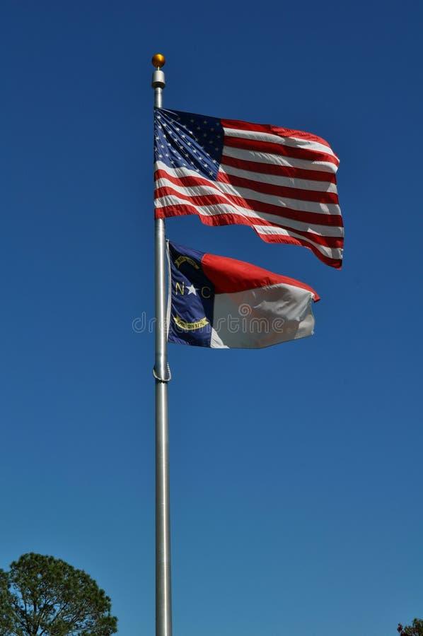 美国人和北卡罗来纳旗子 库存图片