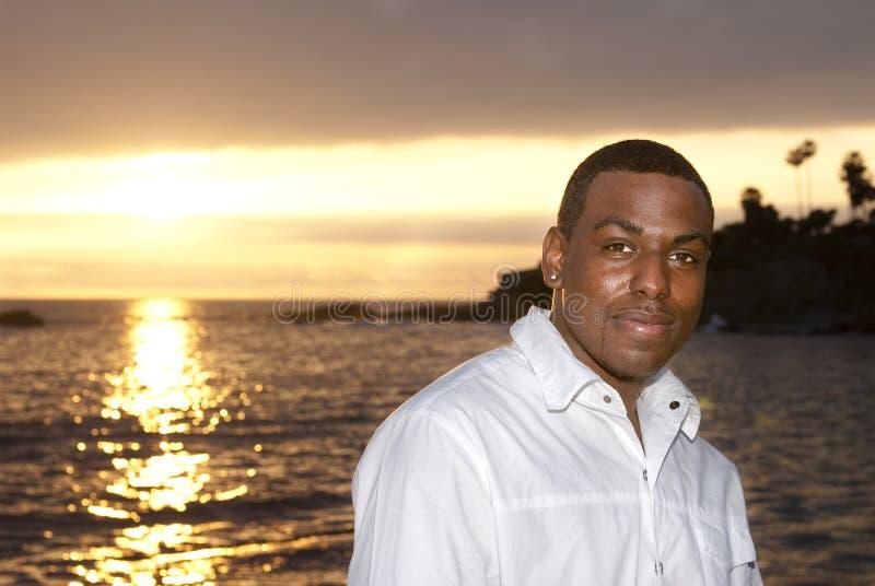 美国人日落的非洲人 库存图片