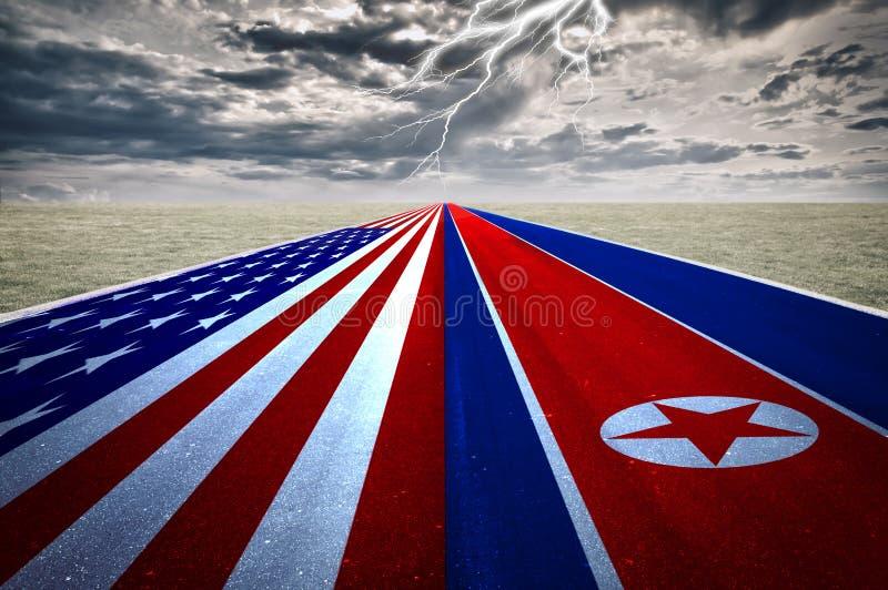 美国和北朝鲜的旗子路的,风暴背景 冲突的概念在两国家、华盛顿和平壤之间的 库存照片