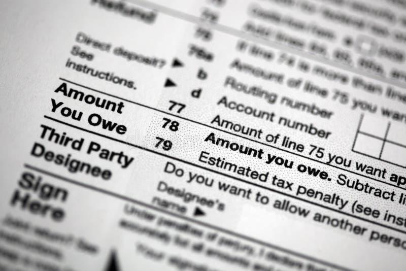 美国报税表集中于您欠的数额 免版税图库摄影