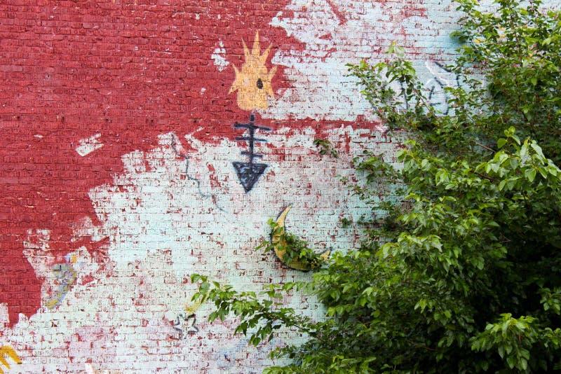 美国本地人壁画特写镜头在砖墙上的在土尔沙大约2010年5月的俄克拉何马美国 库存图片