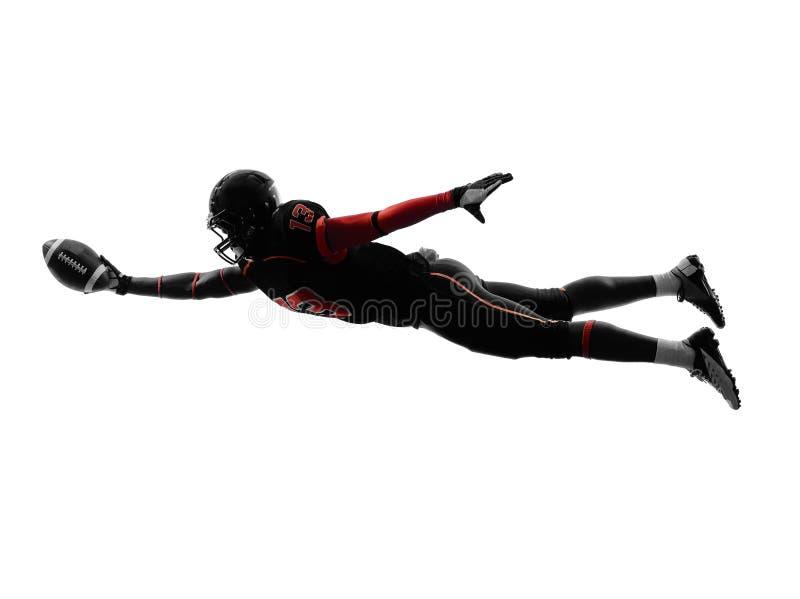 美国橄榄球运动员计分的触地得分剪影 免版税图库摄影