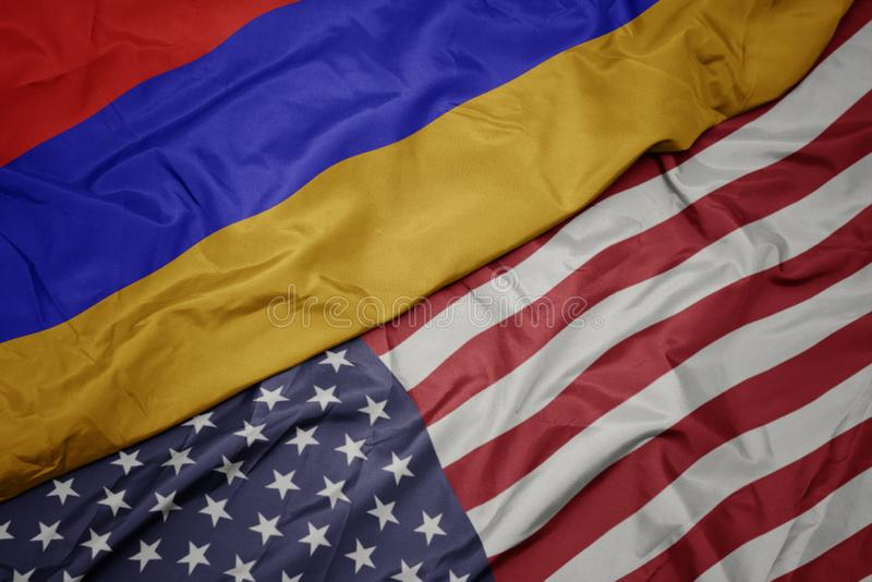 美国的挥动的五颜六色的旗子和亚美尼亚的国旗 库存图片