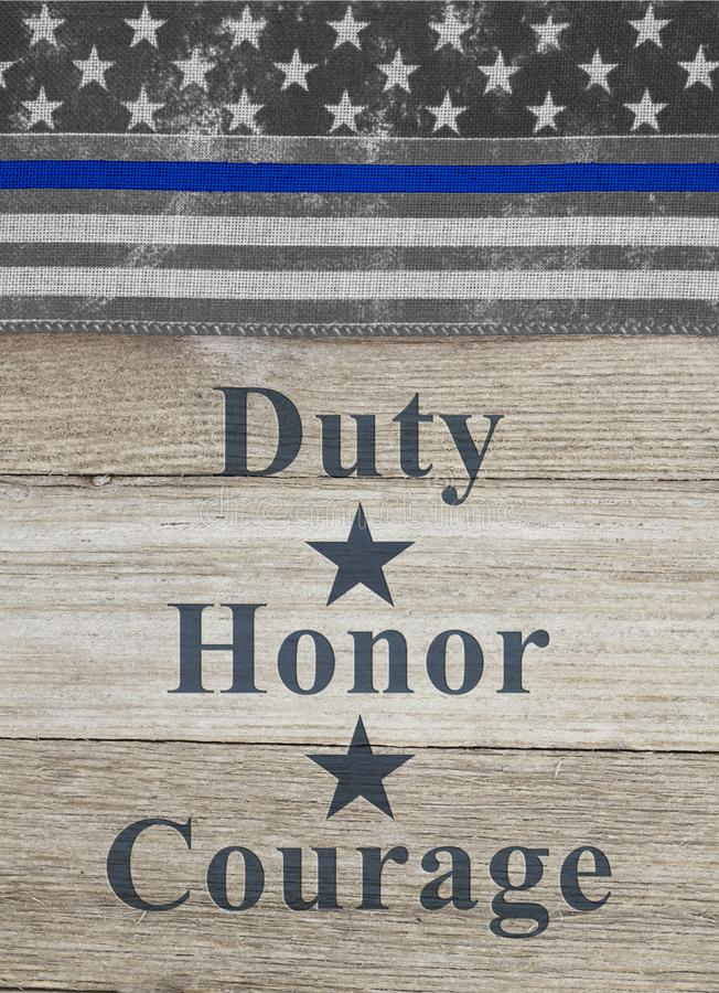 美国稀薄的蓝线旗子义务荣誉勇气文本 免版税库存照片