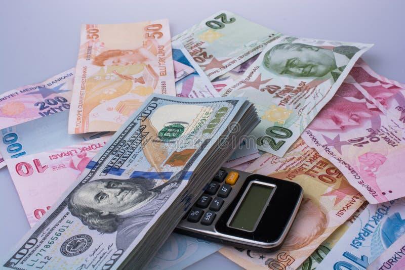 美国美元钞票和Turksh里拉钞票由sid支持 图库摄影