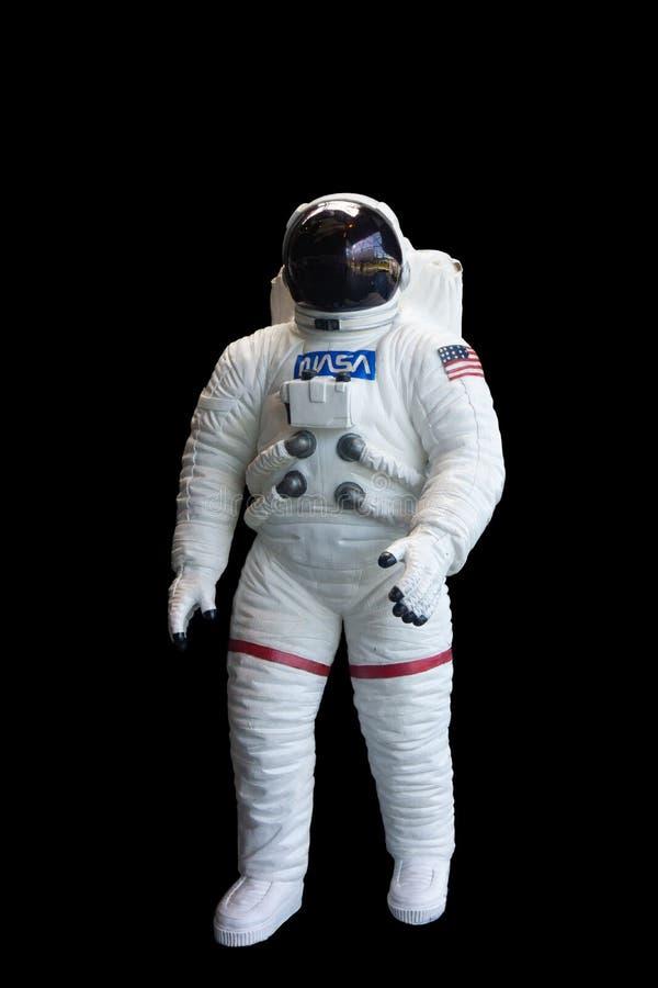 美国航空航天局宇航员航天服垂直的黑背景 免版税图库摄影
