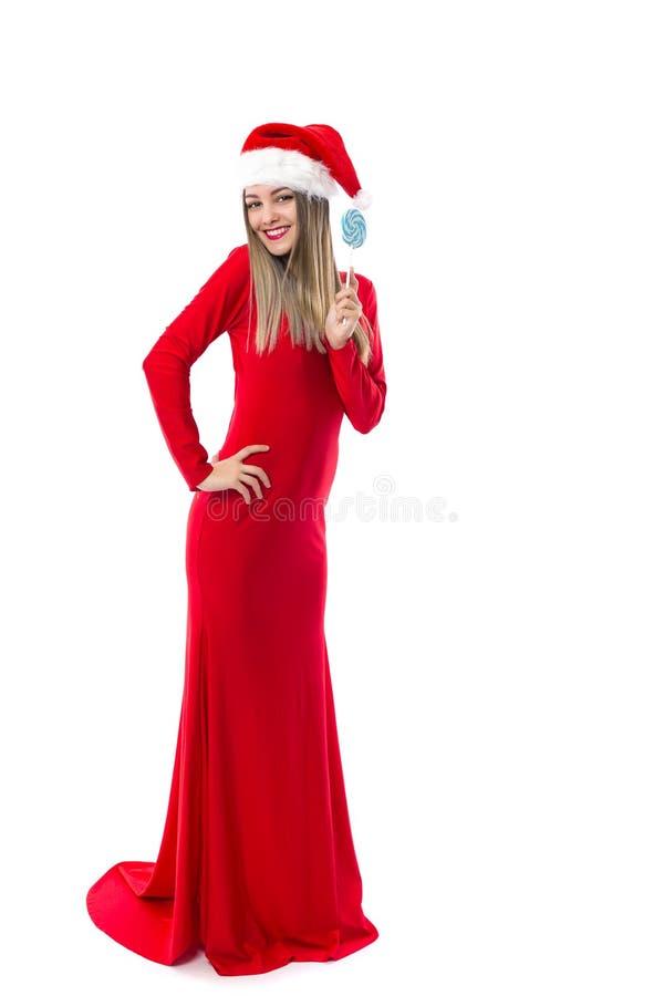 美女全长画象长的红色礼服的有sa的 免版税库存照片