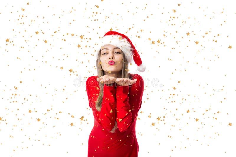 美女特写镜头画象红色的与圣诞老人帽子藏品 免版税库存图片