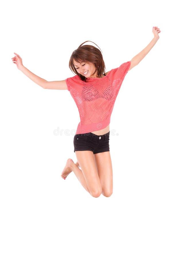 年轻美好亚洲妇女跳跃喜悦-亚裔人民 免版税图库摄影