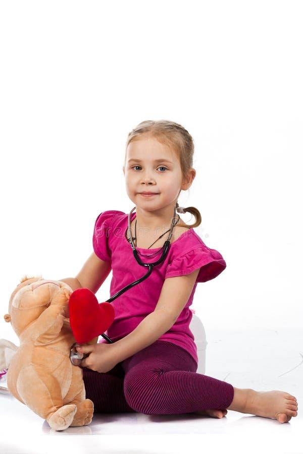 美好医生玩偶女孩使用 图库摄影