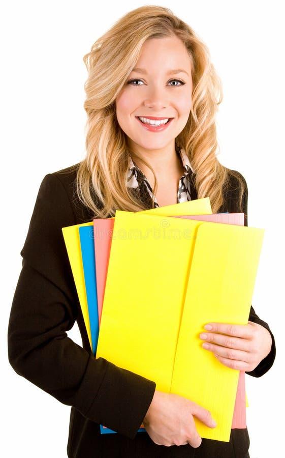美好白肤金发女实业家微笑 免版税库存图片