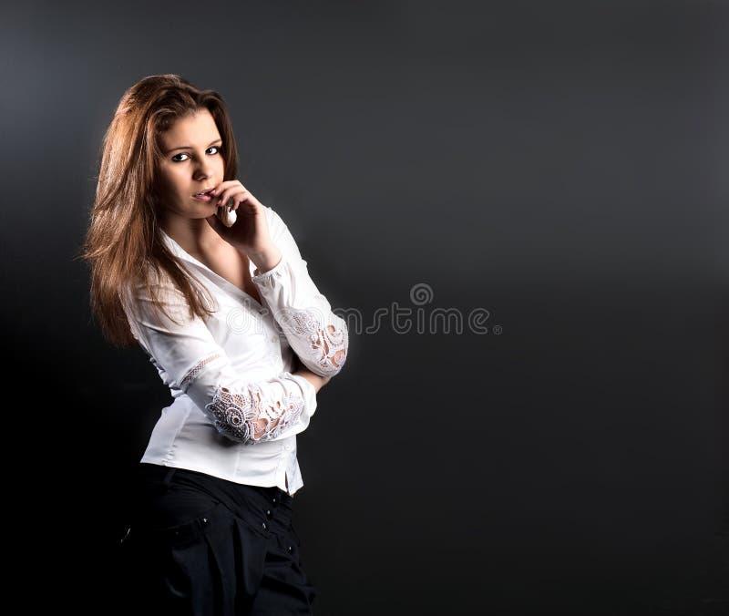 美好的企业微笑的妇女年轻人 免版税库存图片