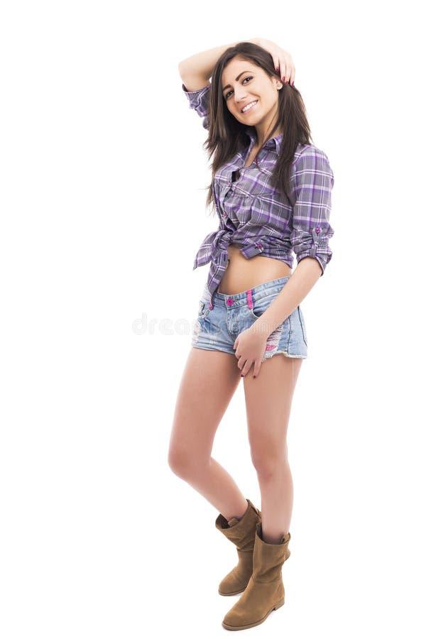 美好的十几岁的女孩佩带的时尚全长画象  免版税库存图片