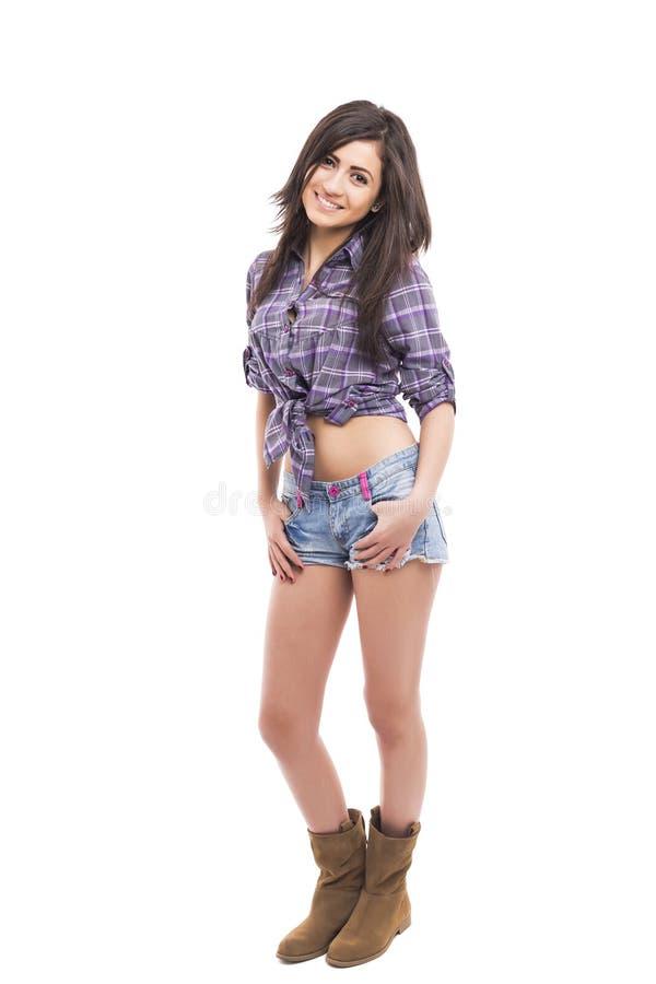 美好的十几岁的女孩佩带的时尚全长画象  免版税库存照片