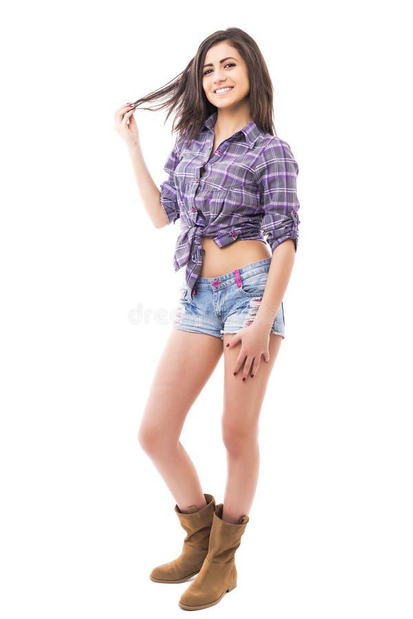 美好的十几岁的女孩佩带的时尚全长画象  库存图片