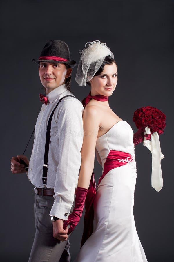 美好的夫妇减速火箭的样式婚礼 库存图片