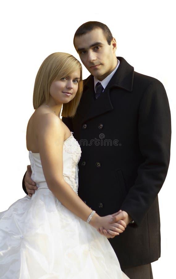 美好的已婚夫妇在婚礼之日 在白色隔绝的婚礼夫妇 图库摄影