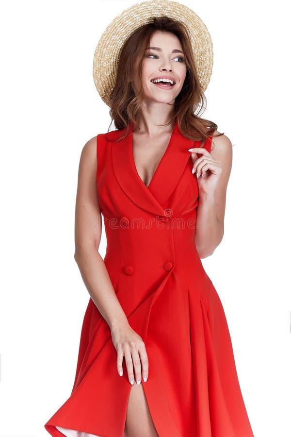 美好的性感的妇女长的深色的头发穿戴红色棉花礼服st 库存照片