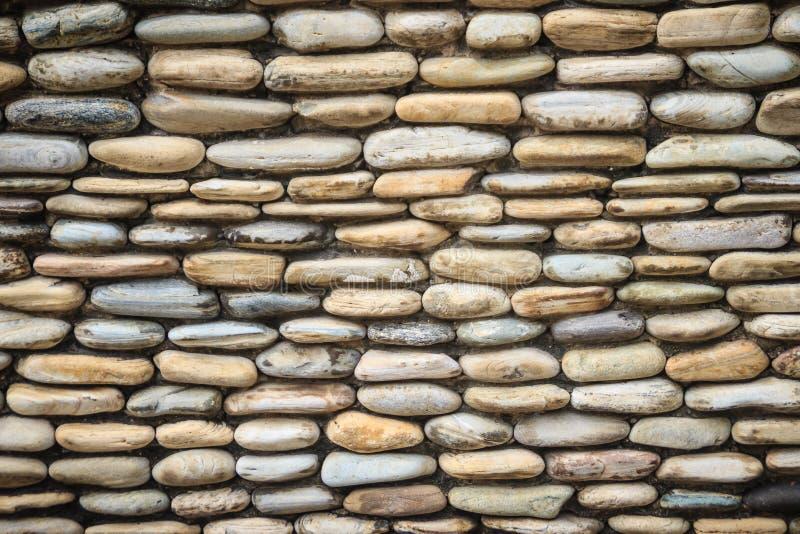 美好的河小卵石墙壁背景 无缝的小卵石石头fl 免版税库存图片