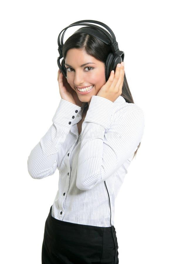 美好的深色的女实业家听证会音乐 免版税库存照片