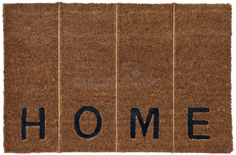 美好的灰棕色和黑zute/粗硬纤维室外门前的擦鞋棕垫有'H O M E'文本和垂直线的 图库摄影