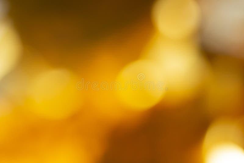 美好的秋天背景的被弄脏的轻的bokhe 图库摄影