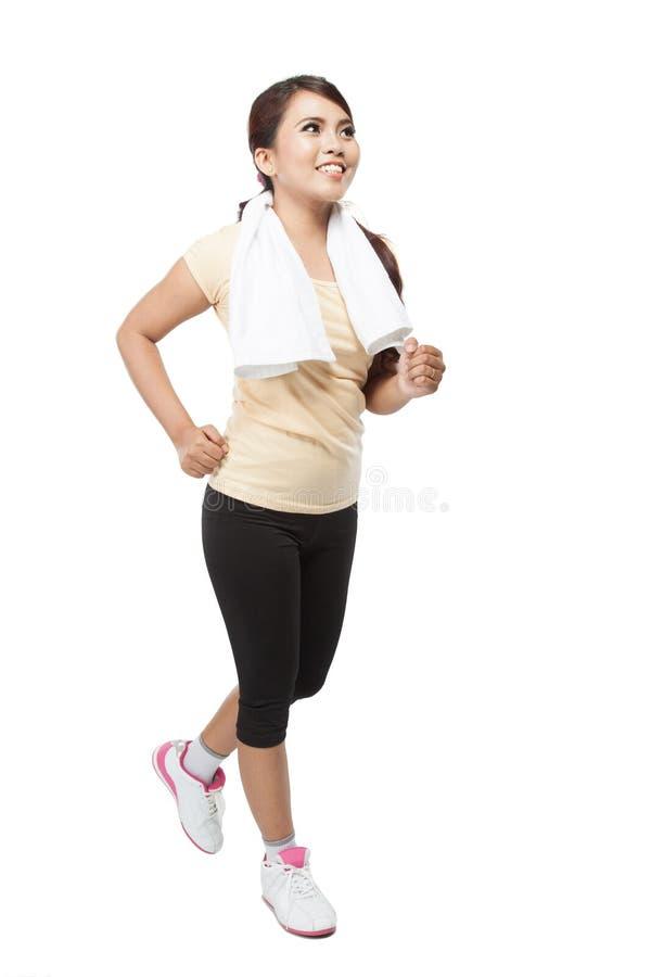美好年轻亚洲妇女跑步室内,隔绝 免版税库存照片