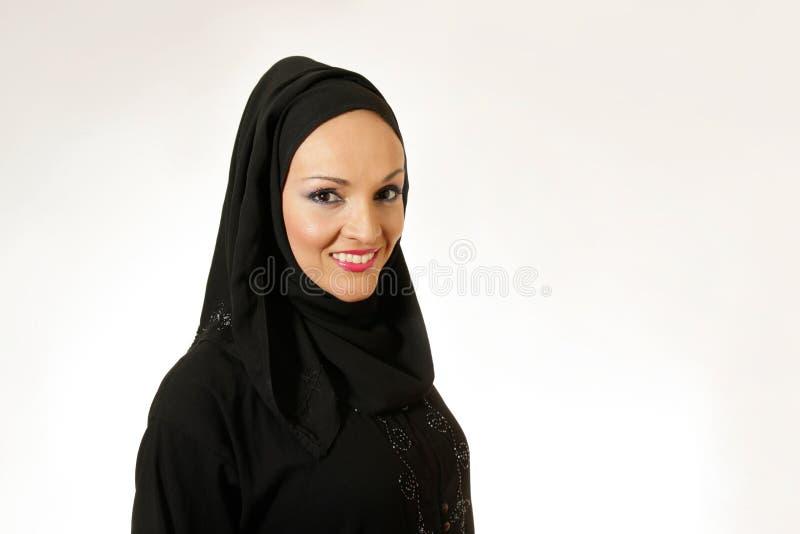 美好年轻阿拉伯妇女微笑 库存照片