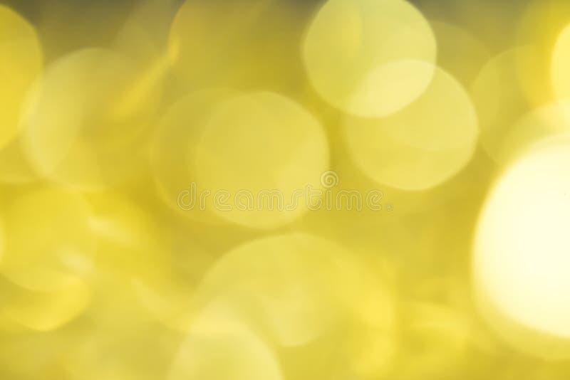 美好Bokeh金黄的背景 构想圣诞节 图库摄影