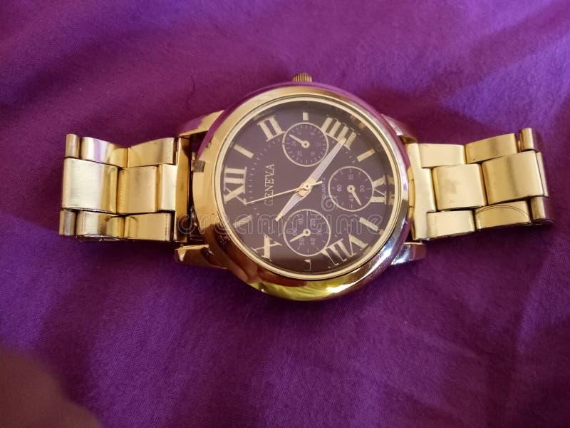 美妙日内瓦金黄的手表 免版税库存图片