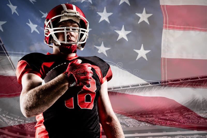 美式足球球员的综合图象拿着橄榄球球的盔甲的 免版税库存图片