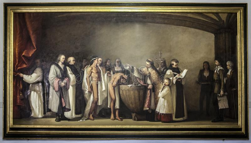 美洲印第安人洗礼的绘画给西班牙带来了  免版税库存照片