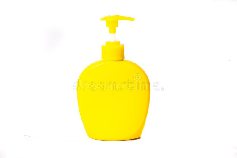 美观的黄色肥皂喷雾瓶或洗发水完全一样的广告颜色 图库摄影