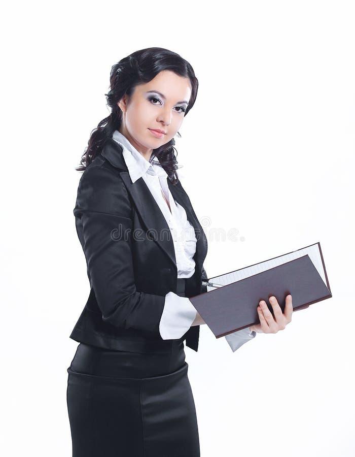 翻转通过文件文件夹的女商人  : 库存照片