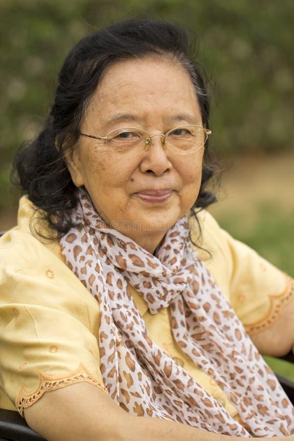 老亚裔中国妇女 库存照片