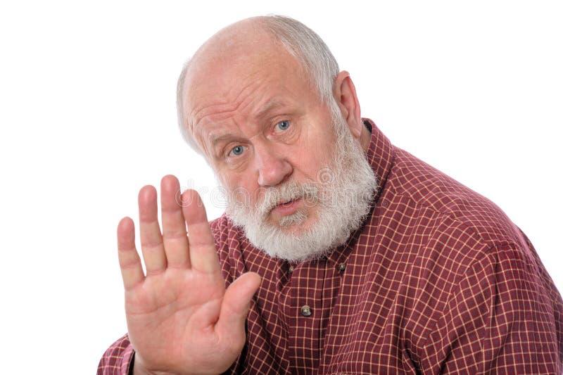 老人展示与手势谈话,隔绝在白色 库存图片