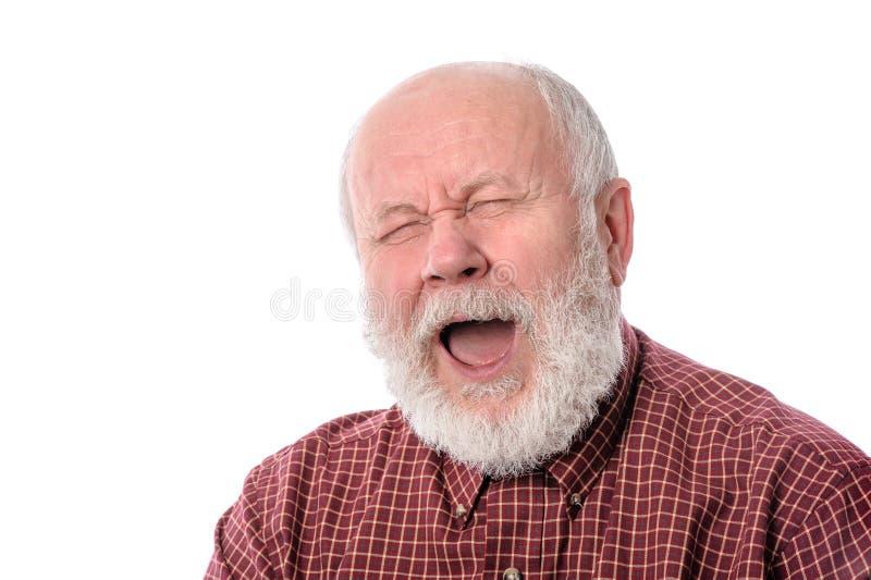 老人打呵欠,隔绝在白色 免版税库存图片