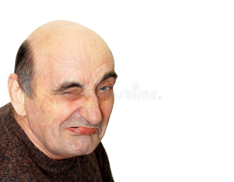 有一副鬼脸的老人在他的面孔 图库摄影