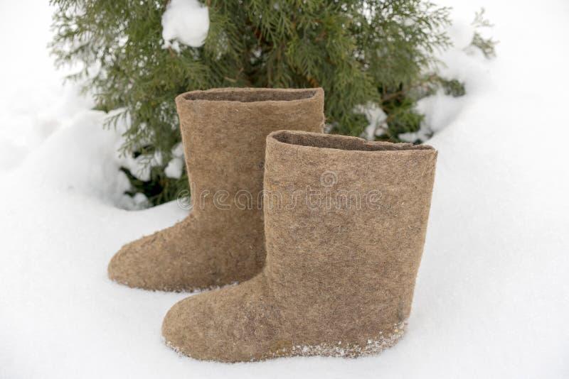老全国传统俄国冬天鞋类是感觉的起动 名字valenki逐字地意味做由毡合 库存照片