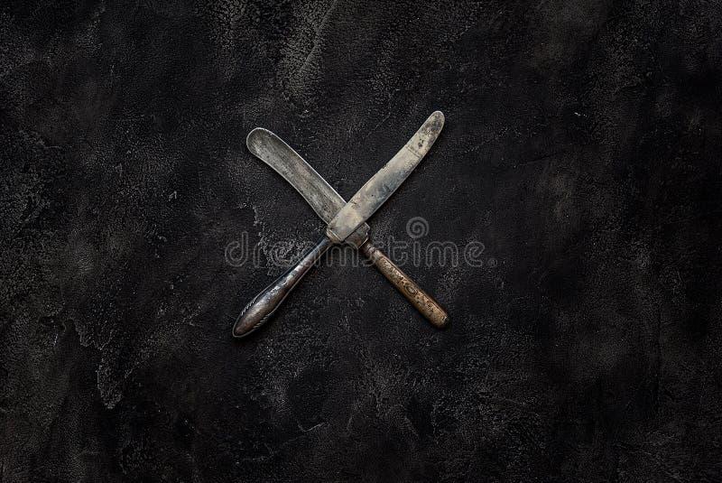 老农庄刀子x在具体顶视图 库存照片
