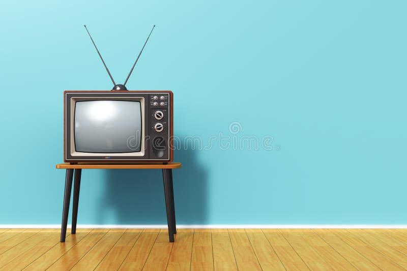 老减速火箭的电视对蓝色葡萄酒墙壁在屋子里 免版税库存照片