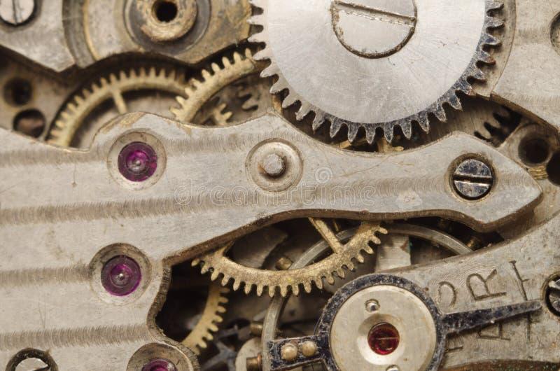 老减速火箭的钟表机构背景 免版税图库摄影