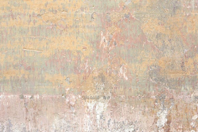 老切削的和被抓的墙壁纹理背景 免版税库存照片